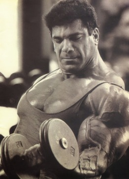 Lou Ferrigno performing dumbbell curls